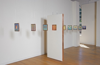 <h5>Walking Through Walls, Installation of double-sided paintings (backs), The Art Gym, Marylhurst University, Marylhurst, Oregon, 2007</h5><p>Oil and copper on panels, door, with multiple 10 x 10 inch panels, 7 x 3 x 14 feet approximate, dimensions variable</p>
