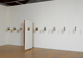 <h5>Walking Through Walls, Installation of double-sided paintings (backs), The Art Gym, Marylhurst University, Marylhurst, Oregon, 2007</h5><p>Oil and copper on panels, door, with multiple 10 x 10 inch panels, 7 x 3 x 14 feet approximate, dimensions variable																																																																				</p>